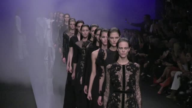stockvideo's en b-roll-footage met final round of models and designer salute at elie saab aw 2013 fashion show in paris elie saab aw 2013 show final salute on march 06 2013 in paris... - 2013