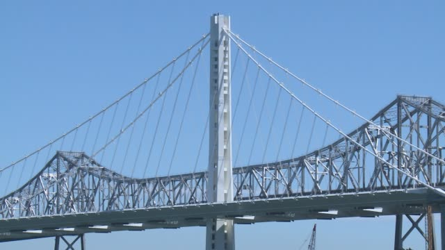 vídeos de stock e filmes b-roll de final work on the new spans of the bay bridge from san francisco to oakland new bay bridge at from treasure island on september 03 2013 in san... - san francisco oakland bay bridge