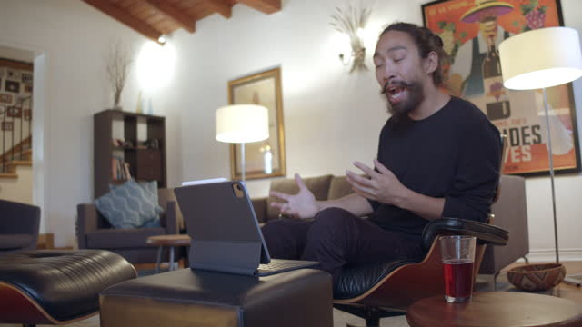 a financial advising client, working from his home, meets via video conference with his financial advisor - ponytail stock videos & royalty-free footage