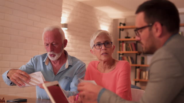 financial advisor facing family with bad news - retirement stock videos and b-roll footage