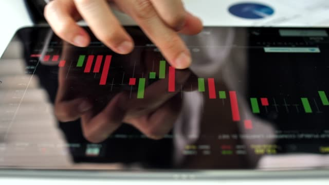 financial analysts on digital tablet - global finance stock videos & royalty-free footage