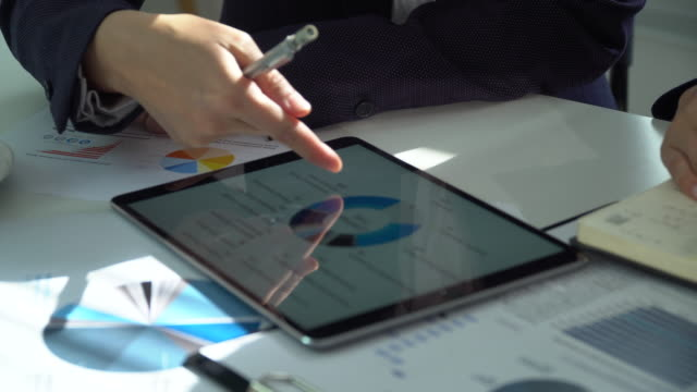 financial analysts see charts and graphs on the screen of the touchpad - search engine stock videos & royalty-free footage