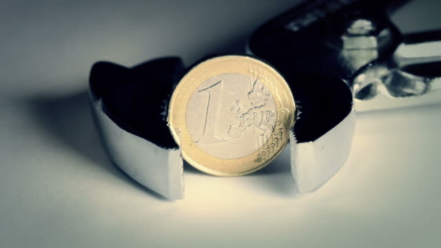 financial crisis and euro: coin hold in a clamp - clamp stock videos & royalty-free footage