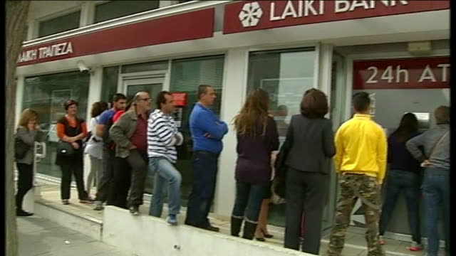 European Central Bank deadline for bailout CYPRUS Nicosia EXT People queuing outside closed bank Woman with hand to mouth Close shot customer at...
