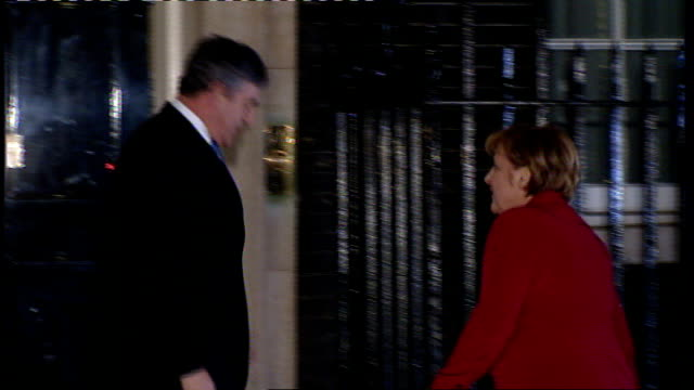 Financial Service Authority report warns of slowdown in British economy ENGLAND London Downing Street PHOTOGRAPHY** Angela Merkel handshake and...