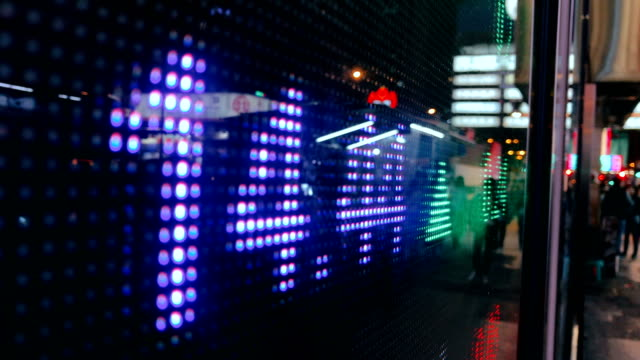financial stock market numbers and city light reflection - digital signage stock videos and b-roll footage