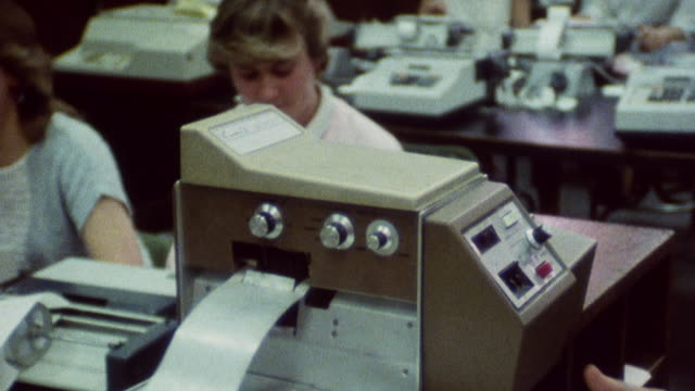 1985 montage financial workers processing documents / city of london, england† - bankgeschäft stock-videos und b-roll-filmmaterial