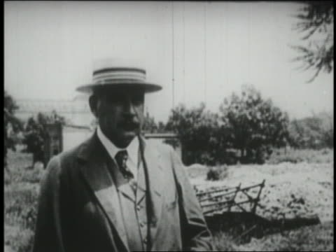 b/w 1930 financier philanthropist jp morgan standing in straw hat in countryside - straw hat stock videos & royalty-free footage