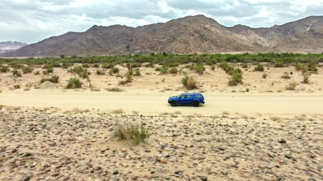finding new routes through the desert landscape - pick up truck stock videos and b-roll footage