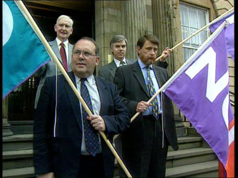 lib ext findlay and other members of the scottish conservative party during campaign against scottish devolution holding flags pan findlay and... - クリシュナン・グルマーフィ点の映像素材/bロール