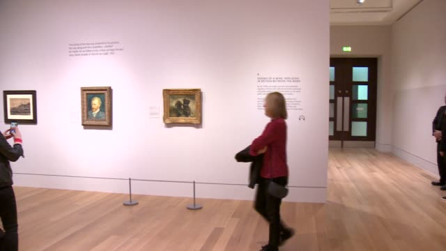 van gogh exhibition opens at tate britain england london tate britain int various shots people admiring / photographing van gogh painting 'self... - fine art portrait stock videos & royalty-free footage