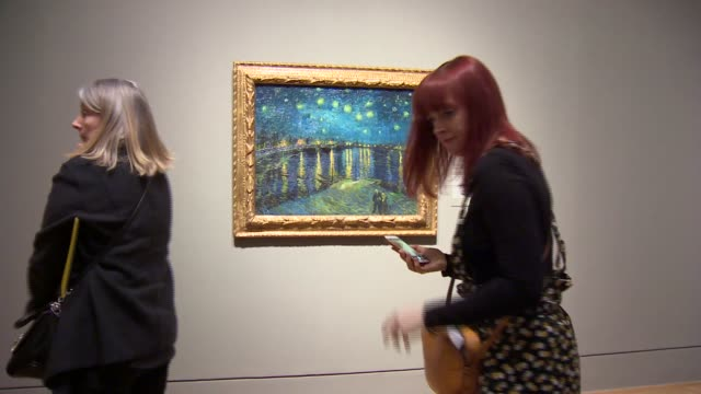 van gogh exhibition opens at tate britain england london tate britain int various shots people looking at / photographing van gogh pieces hanging in... - fine art portrait stock videos & royalty-free footage