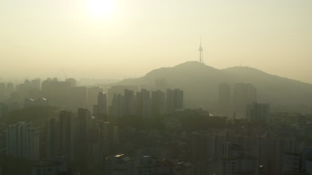 fine dust covering downtown area and n seoul tower (landmark building of seoul) / seodaemun-gu, seoul, south korea - grainy stock videos & royalty-free footage
