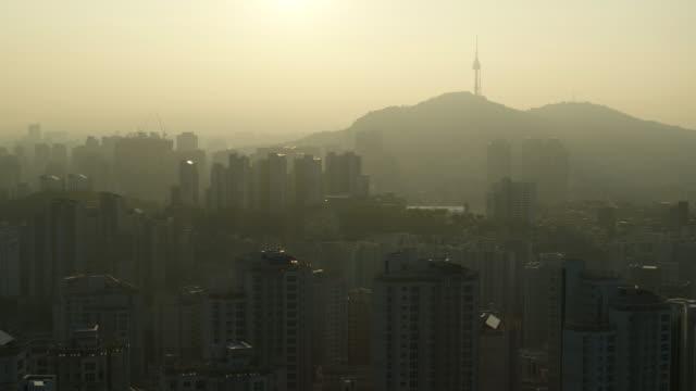 fine dust covering downtown area and n seoul tower (landmark building of seoul) / seodaemun-gu, seoul, south korea - grainy stock videos & royalty-free footage