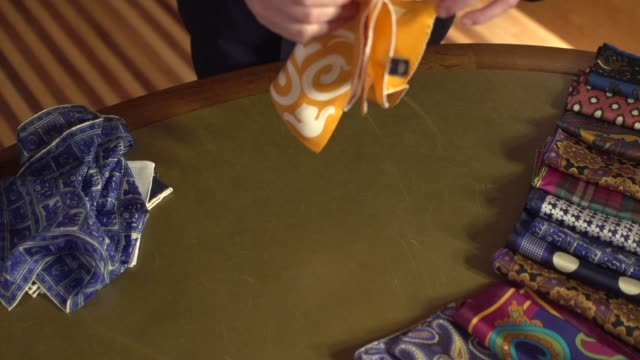 fine men es clothing-flipping a handtuch in slow motion - maßkonfektion stock-videos und b-roll-filmmaterial