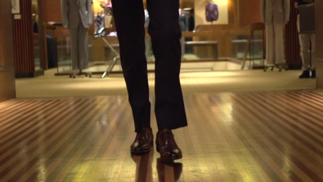fine men's clothing - walking down the hall slow motion - tailored clothing stock videos & royalty-free footage