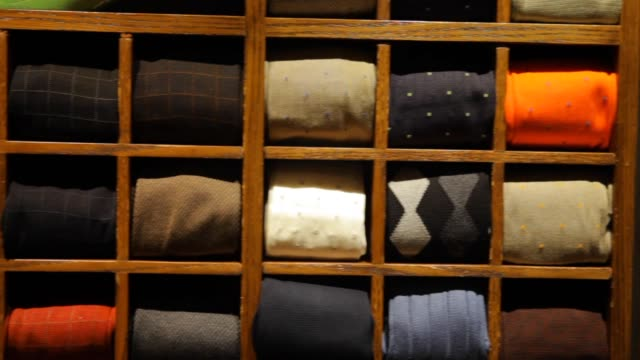 fine men's clothing - wall of folded sweaters - jumper stock videos & royalty-free footage