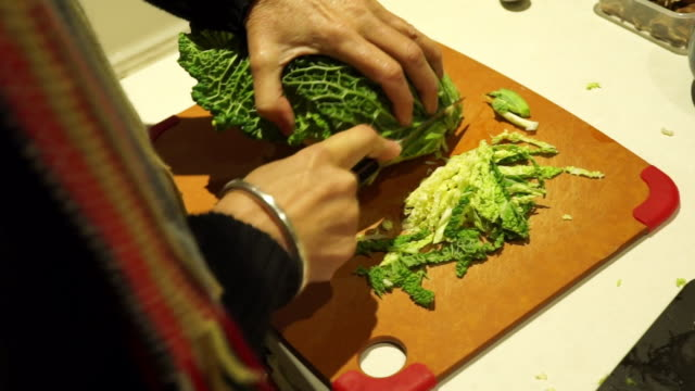 finely slicing savoy cabbage for meal - savoy cabbage stock videos & royalty-free footage