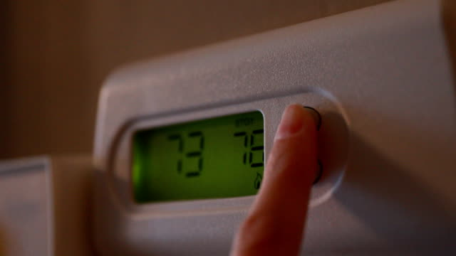 finger changing thermostat - off stock videos & royalty-free footage