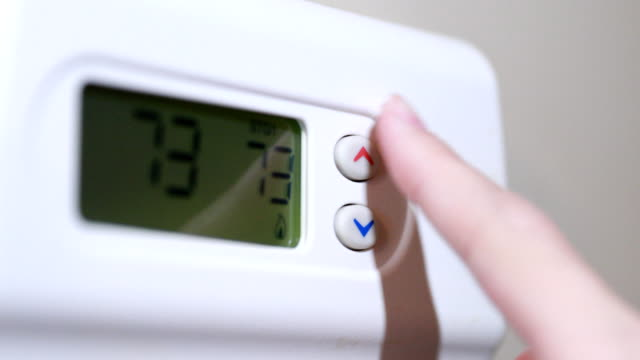finger changing thermostat - thermometer stock videos & royalty-free footage
