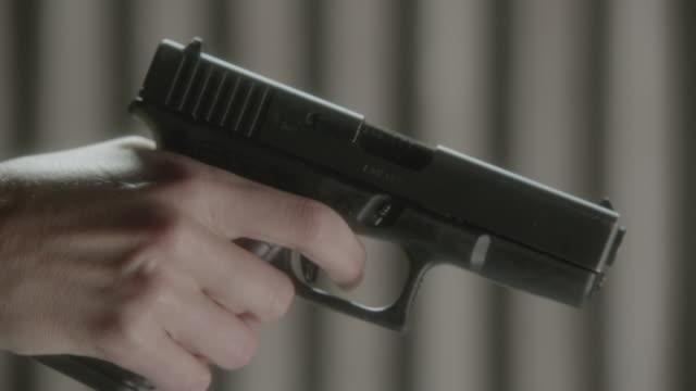 cu finger moving on trigger of handgun - trigger stock videos & royalty-free footage
