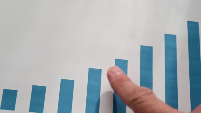 finger of a person (man) indicating an ascending data graph. growth times. - line graph stock videos & royalty-free footage