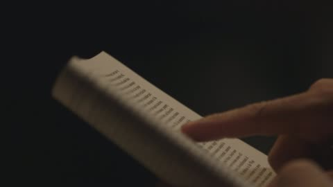 finger pointing at page of a book - library stock videos & royalty-free footage