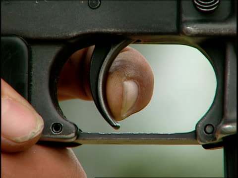 a finger pulls the trigger of a rifle. - trigger stock videos & royalty-free footage