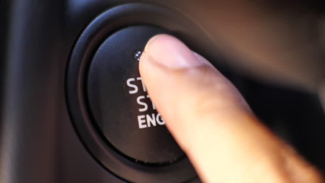 finger push engine start button ,push to start car - start button stock videos & royalty-free footage
