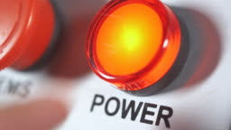 Finger pushing button power on. Start engine electrical equipment in industrial factory. Panel with red plastic round press button. Beginning of work. Switch on. Turning on the electricity.