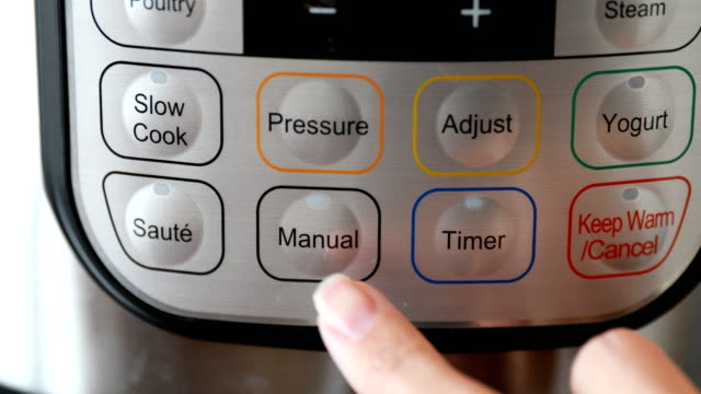 finger pushing pressure cooker button - cooking pan stock videos & royalty-free footage