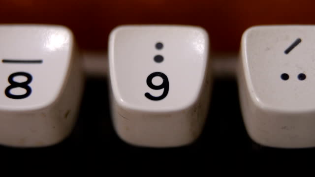 finger typing number 9 on old, retro typewriter - number 9 stock videos & royalty-free footage
