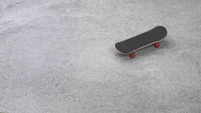 fingerboard rolling on stone ground stop motion animation - figurine stock videos & royalty-free footage