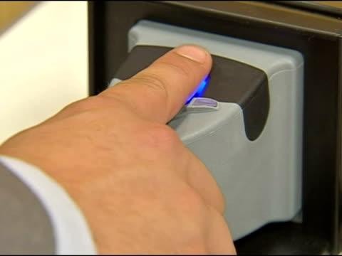 fingerprint scanner demonstrated at biometric technology exhibition - fingerprint stock videos & royalty-free footage