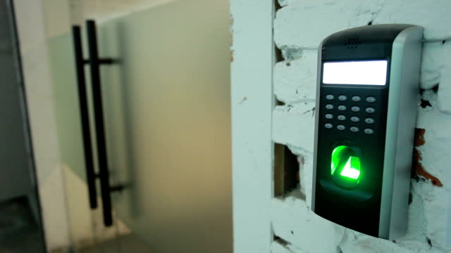 fingerprint scanner for security on the wall of entrance. - computer key stock videos and b-roll footage