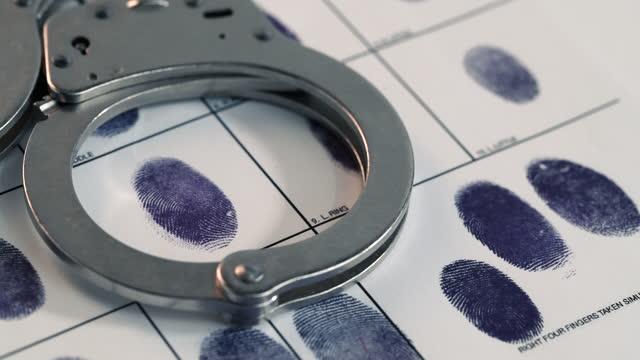 fingerprints - handcuffs stock videos & royalty-free footage