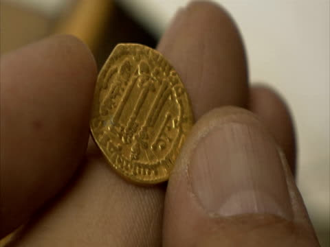 cu fingers holding ancient gold coin, syria (sound available) - ancient stock videos & royalty-free footage