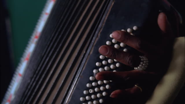 fingers of musician changing position over buttons of accordion available in hd. - akkord stock-videos und b-roll-filmmaterial