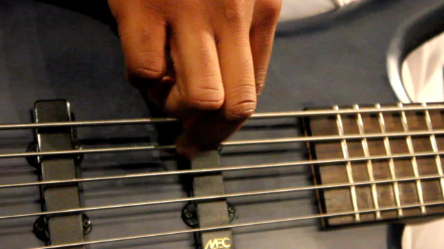 cu fingers plucking bass guitar / johannesburg/ south africa - bass guitar stock videos & royalty-free footage
