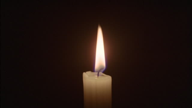 fingers put out the flame of a candle. - candle stock videos & royalty-free footage