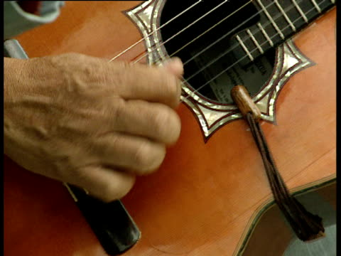 fingers strumming guitar strings. - plucking an instrument stock videos & royalty-free footage