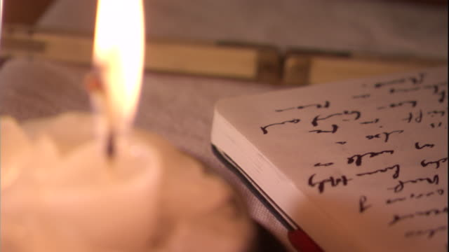 fingers turn the pages of a notebook. available in hd. - candle stock videos and b-roll footage