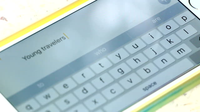 Fingers typing message.