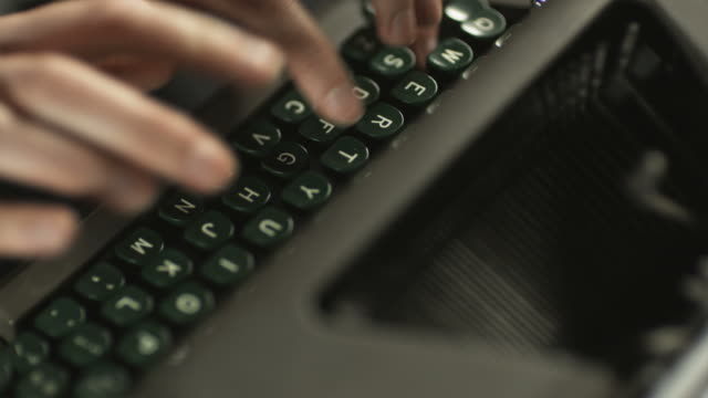 fingers typing on the keyboard of an old-fashioned typewriter - typewriter keyboard stock videos & royalty-free footage