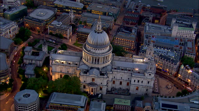 A finial tops the dome of St. Paul's Cathedral in London, England at night.