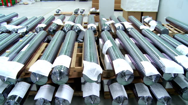 ms pan finished crystals stacked in rows after completion of crystal growing process in furnaces at solar manufacturing plant solarworld, hillsboro, oregon, usa - plant process stock videos & royalty-free footage
