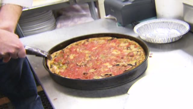 wgn finished pizza coming out of oven on october 12 2012 in chicago illinois - savory food stock videos and b-roll footage