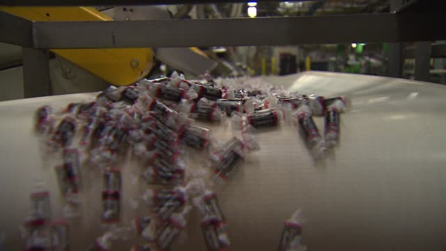 wgn finished tootsie rolls on conveyor belt in factory on conveyor belt on november 01 2012 in chicago illinois - wrapping stock videos and b-roll footage