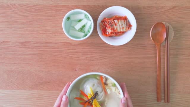finished tteok mandu guk (korean rice cake soup with dumplings) - korean new year stock videos & royalty-free footage