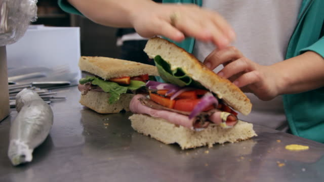 finishing sandwiches - making a sandwich stock videos and b-roll footage